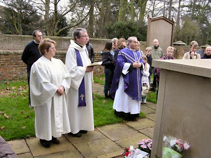 The dedication of the monument in the Garden of Remembrance by the Venerable Paul Hughes, Archdeacon of Bedford